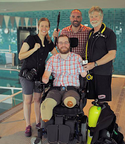 Robin Berghaus, Kevin McCarthy and Sam Kauffmann with Will Lautzenheiser at Spaulding Rehabiltation Hospital. Photo by Abbey Turner